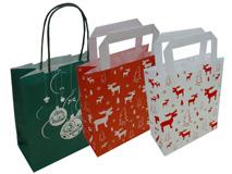 Tragetaschen aus Papier mit Weihnachtsmotiv bedruckt